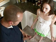 Cute teen babe blows handymans huge boner