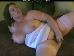 Busty BBW in stockings gives blowjob