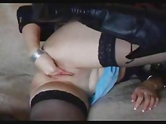 Cute blond in leather boots fisting herself