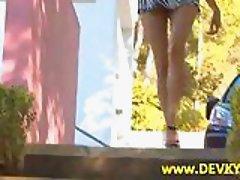 Brunette girl pissing outdoor