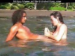 Interracial blowjob in the river