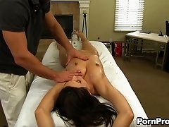 Small tits slut on the massage table gets fucked
