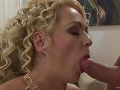 Blonde cougar with big natural tits enjoying a hardcore fuck on her bed