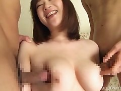 Provocative Japanese girl with large tits having a nice threesome