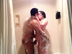 Sultry brunette milf gets pounded doggystyle in the shower