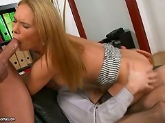Two co-workers analyze one busty secretary in stockings