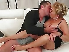 Busty granny gets fucked on sofa