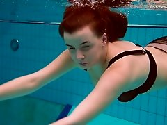 Russian redhead dives around the pool showing off her perfect body