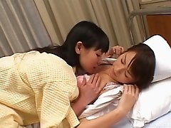 Naughty Japanese nurse seduces her patient into a heated lesbians action