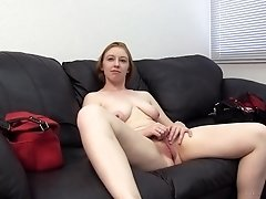 Curvy cock swallowing redhead fucked over a desk