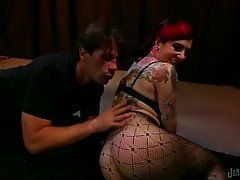 Tattooed bitch in pantyhose lets a guy toy her holes