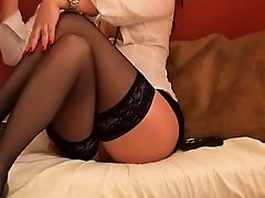 Hot Brunette In Stockings Fucks Her Pussy With