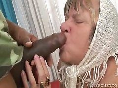 Big breasted Russian granny sucks big black dick greedily