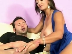 Busty cougar mature wanking his dong