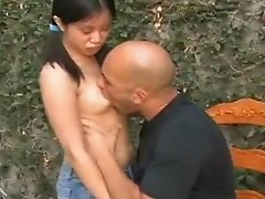 Nasty Brunette Gives A Handjob To Well Hung Guy Outdoors