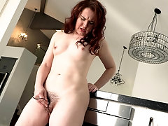 Curly haired brunette MILF Annabelle makes her pussy cum with toys