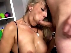 Busty babe plays with a fat shaft