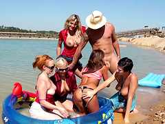 Outdoor group screwing on the beach doggystyle with sexy models