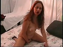 Solo model in high heels drilling her pussy using a toy in realty shoot