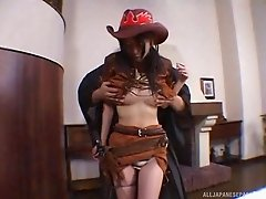 Dressed like a naughty cowgirl this Japanese girl attacks that cock