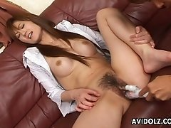 Fake tits are quite sexy on the Japanese girl taking a toy inside her