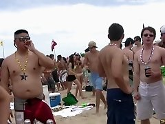 Dance party on the beach with lots of hotties in bikinis