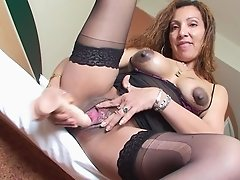 Charming mature Chelesta screwing her shaved pussy using toy