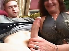 Lustful redhead granny giving head to horny young guy