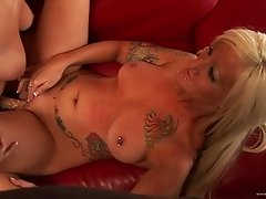 Tattooed Lesbian Gets Fucked by Mature Blonde and Her Strapon