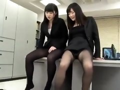 Two pantyhosed Japanese cuties tease a guy with their feet