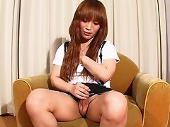 Long haired feminine Japanese tgirl jerks off solo