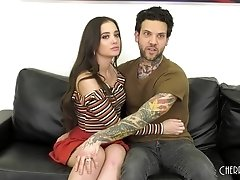 Kinky Gia Paige gets her cunt pounded by a tattooed guy on the couch