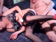 Slutty amateur granny in lingerie gets shared by two guys