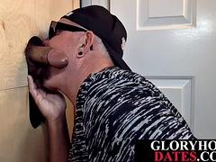 Gloryhole DILF sucking and tugging black cock