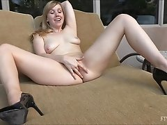 Blonde amateur fingering & fisting her pussy deep sitting outdoors