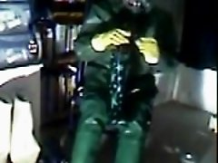 An old vid wanking in green rubber.