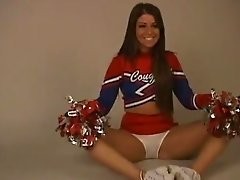 A cute amateur cheerleader strips off her uniform and gets naked