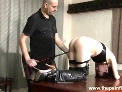 Brunette slave is punished with hot wax and hard spanking