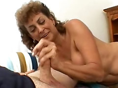 Filthy mature whore Sophia is energetically sucking her lover's man meat