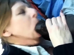 Sweet blonde has a big black dick unloading in her mouth