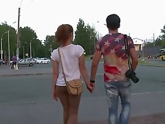 Curly red haired babe gives eager blowjob to photographer from the street