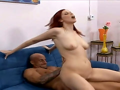 Wild and emotional redhead is poked doggy and gives stud a ride
